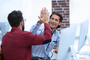happy employees giving each other high five