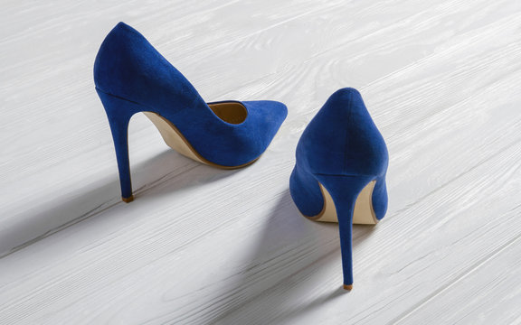 Blue high heels Shoes pair on wooden floor