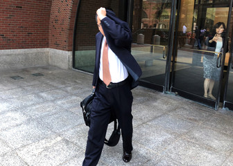 Former Merrimack Pharmaceuticals Inc. employee Songjiang Wang exits the federal courthouse in Boston