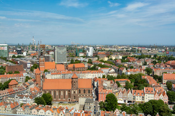 8 July 2018, Townscape  with red roofs in old city Gdansk, Poland, made from top, aerial landscape with tilt-shift effect in summer