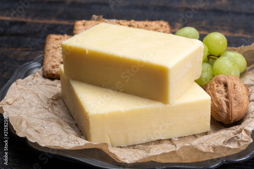 Block of aged cheddar cheese, the most popular type of