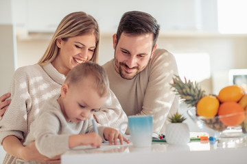 Young family drawing at home