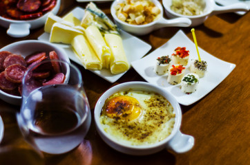Set with different appetizers in small portions, healthy and delicious snacks