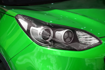 Right headlight of the new clean green color sports car
