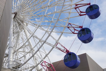 Ferris wheel on the roof of building in matsuyama city,ehime,shikoku,japan