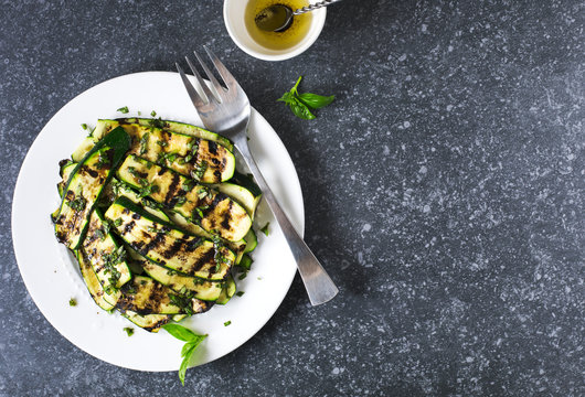 Grilled zucchini with basil and olive oil