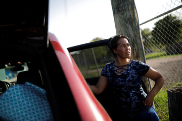 Janet, an asylum seeker from Honduras, leaves Casa Antigua shelter in Brownsville, Texas, U.S., shortly after meeting her 16-year-old daughter for the first time since their separation at the U.S.-Mexico border
