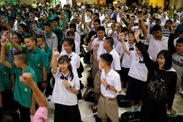 Students of Mae Sai Prasitsart School, where some of the trapped boys study at, celebrate after the 12 soccer players and their coach were rescued from the Tham Luang cave complex, in the northern province of Chiang Rai