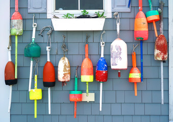 colorful fishing float hanging outside the house