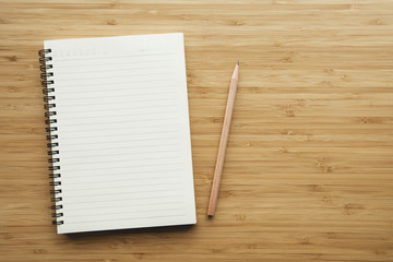 Notebook on wood table background.