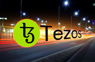 Concept of Tezos coin  moving fast  on the road, a Cryptocurrency blockchain platform