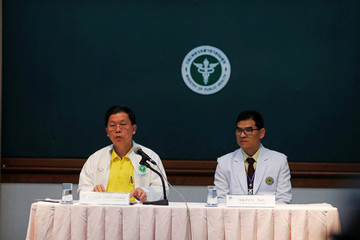 Thongchai Lertwilairatanapong, inspector general of the public health ministry, and Chaiwetch Thanapaisal, director of the Chiang Rai Prachanukroh Hospital, attend a news conference in Chiang Rai, Thailand