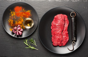 Wall Mural - Raw marbled meat Steak, herbs, spices and metal scales