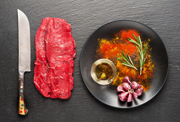 Wall Mural - Raw beef steaks, herbs and seasonings
