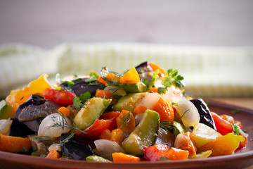 Vegetable stew: eggplant, pepper, tomato, zucchini, carrot and onion. Stewed vegetables salad. horizontal