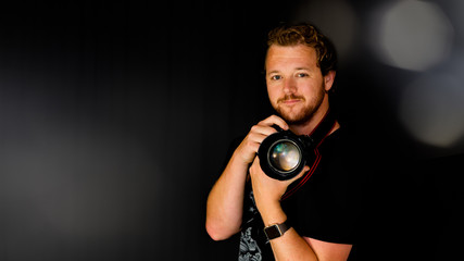 A photographer holds his camera