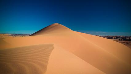 Sunset view to Tin Merzouga dune at Tassili nAjjer national park in Algeria