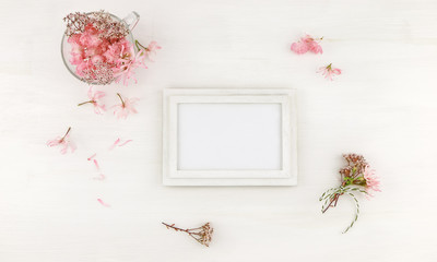 Flatlay wooden frame mockup with pink flowers