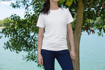 Cropped image of young hipster girl wearing blank white t-shirt and black jeans, mock-up of blank white t-shirt