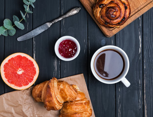 Breakfast flat lay with pastry, coffee and jam