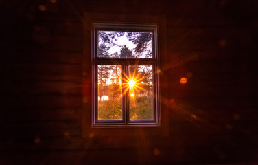 Sunset view in old window. Photo from Sotkamo.