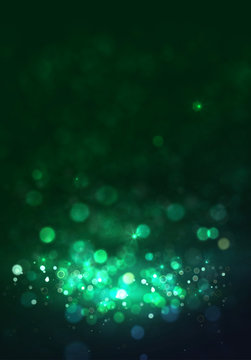 Magic green background with bokeh.