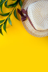 Summer vacation concept flat lay. Beach accessories top view on a yellow background. Space for text. travel