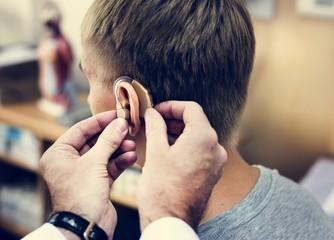 A man having his ears checked Fototapete