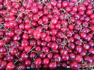 red cherries just told very appetizing ready for sale