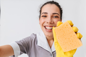 Portrait of an excited young housemaid