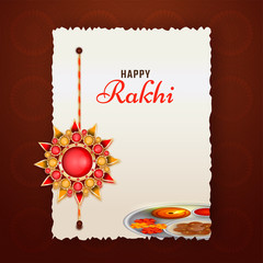 Raksha Bandhan greeting card design on brown background with beautiful rakhi (wristband) made by colorful stones.