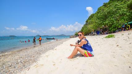 A girl sitting on the beach in Koh Kham Island, Chonburi