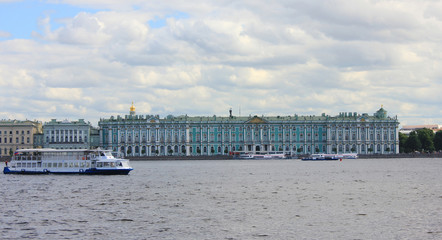 Winter Palace and Hermitage Museum Architecture View from Neva River Waterfront. Russian Royal Family Palace and Cruise Tour Boat in Front of Famous City Tourist Landmark on Summer Day Scene.