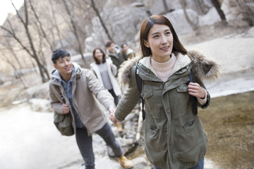 Happy young Chinese friends enjoying winter outing