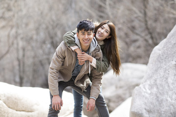 Portrait of happy young Chinese couple outdoors in winter