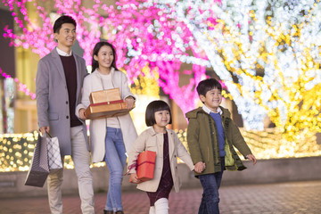 Cheerful young family shopping for Chinese new year