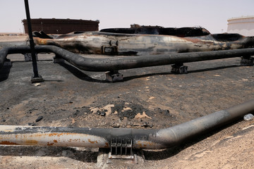 Damaged tanks and pipelines are seen at the oil port of Ras Lanuf