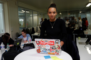 Student Jenna Diop, aged 20, poses in her web development class as part of professional training at the Simplon.co school specialized in digital sector in Montreuil, near Paris