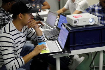 Student Nicky Hour, aged 25, works in his web development class as part of professional training at the Simplon.co school specialized in digital sector in Montreuil, near Paris