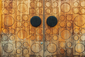 Texture of old wooden door with circle and square ornament