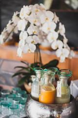 Set of drinks in glass bottles for breakfast, fresh juice, milk, cocktail and milkshakes