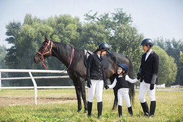 Young Chinese family with horse