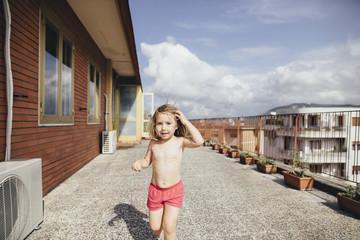 Italy, Naples, portrait of little girl on roof terrace