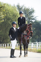 Cheerful Chinese couple riding horse