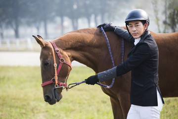 Chinese male rider with his horse