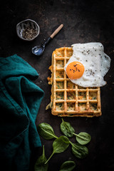 Savory waffle with fried egg and spinach