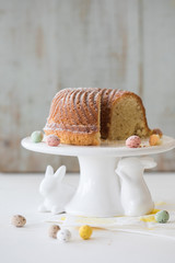 Small easter bundt cake with bunnies and easter eggs