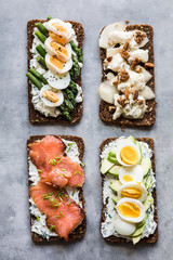 Four different toasts with smorrebrod toppings