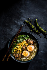 Ramen noodle bowl with egg and corn