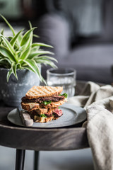 Sandwich with steak on a small table